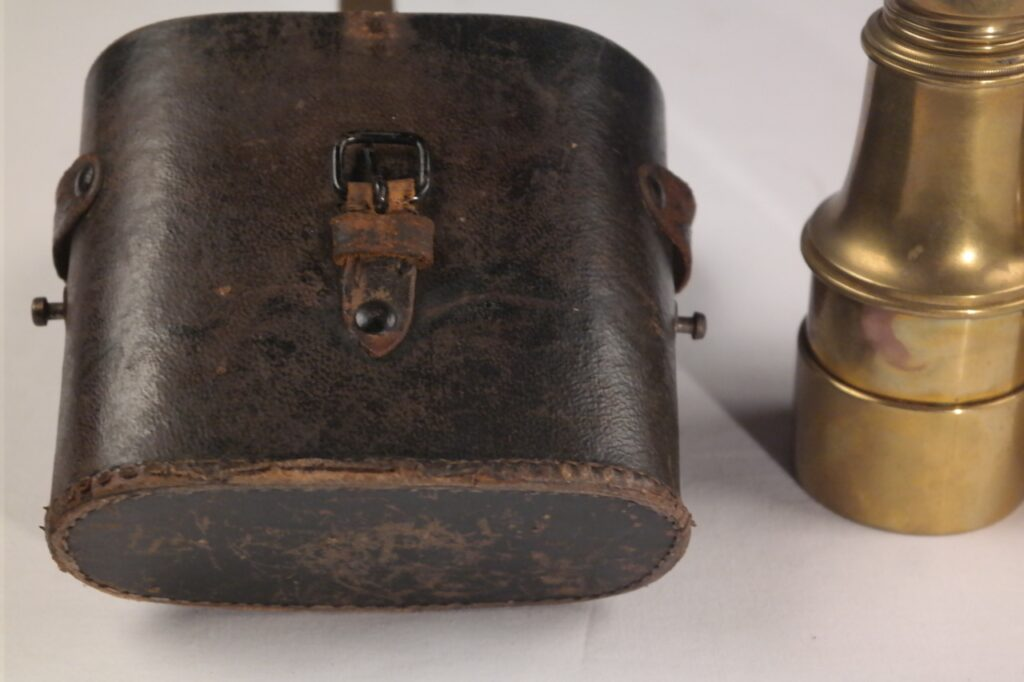 Brass sea binoculars with leather case